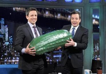 "Seth Meyers receiving the ceremonial big pickle in January from Jimmy Fallon when he was named new host of ""Late Night."""