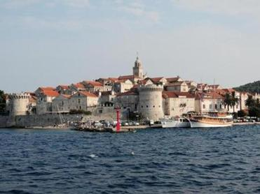 The citadel of Korcula, a town on a peninsula, with architecture ranging from Gothic to Renaissance-Baroque.
