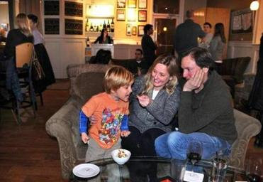 Frans Weterrings, 4, welcomes the hand that feeds him ice cream in the lounge area at Zebra's Bistro and Wine Bar in Medfield. Parents Tiffany Kinder-Weterrings and Frans came prepared to enjoy their outing.