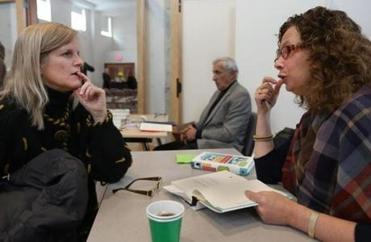 "Parent Anita Meyer (left) has questions and gets a book signed by Catherine Steiner-Adair (right), author of ""The Big Disconnect."""