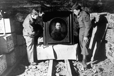 Two of the real Monuments Men inspected a Rembrandt self portrait that was stored in a German mine during WWII.