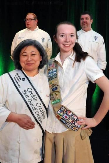 Matt Herron (back, left), lead chef instructor at Le Cordon Bleu College of Culinary Arts, and Earle M. Test (back, right), director of education and executive chef at Le Cordon Blue, judged the Cookie Creations contest on Thursday for the Girl Scouts of Eastern Massachusetts. Their winner was Eunice Feller, seen here with Girl Scout Molly McGowan from Waltham.