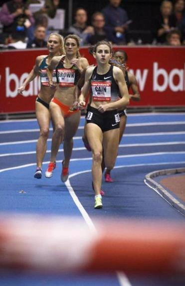 Teenager Mary Cain fell short of  her goal of an American record, but managed to set a personal-best time of 2:35.80 to win the women's 1,000-meter race at Reggie Lewis Center.