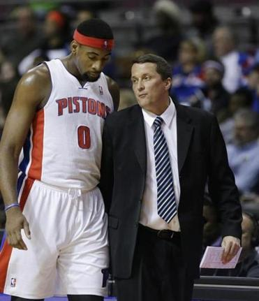 Pistons interim coach John Loyer talks strategy with Andre Drummond.