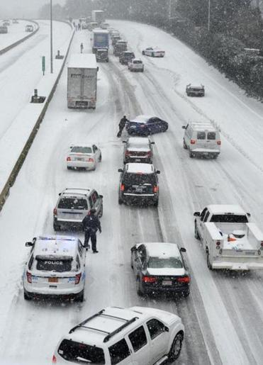 Traffic along Independence Boulevard crawled along the slick roadway in Charlotte, N.C.