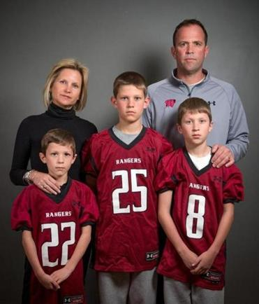 The Good family boys – Jackie, 8, Zack, 12, and Luke, 10 – all play football for the Westborough rangers, coached by dad Jack and cheered by mom Dede.