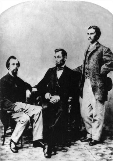 John Nicolay (left) and John Hay with President Lincoln. The two presidential secretaries shaped the public image of the 16th president.