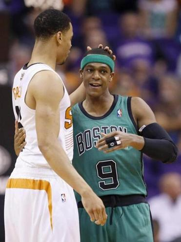 Celtics guard Rajon Rondo (right) is unlikely to be traded, according to a source.