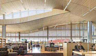 The Boston Public Library's East Boston branch has no interior walls, giving the building a sense of community that is different from the typical library feel created by separate areas for different age groups.