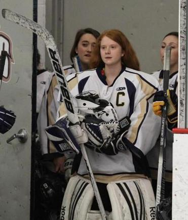 St. Mary's of Lynn goalie Lauren Skinnion and her teammates prepare to take the ice for a recent game against Winchester. The Spartans are defending Division 1 state champions.
