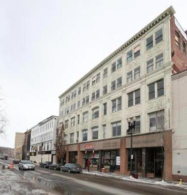 Buildings along a block of Merrimack Street in downtown Haverhill will be demolished to make way for a mixed-use development, including a satellite campus for UMass Lowell, that will also open access to the riverfront.