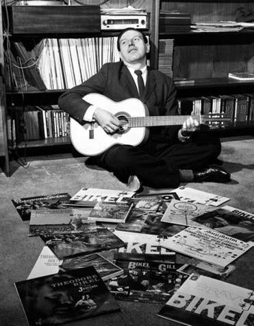 Theodore Bikel strummed his guitar on the floor of his Greenwich Village apartment in New York City, 1959.