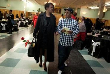 With her grandson, CJ Mills, Dianne Wilkerson left an event where she was honored.