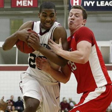 Harvard's Wesley Saunders was carrying on despite the defense of Cornell's Dwight Tarwater, who simply tried to hang on.