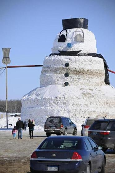 "Greg Novak, a farmer in Gilman, Minn., built a 50-foot snowman named ""Granddaddy."" He said he hoped it would help visitors overcome their frustration with winter's woes."