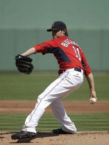 "Clay Buchholz reported ""no problems throughout"" his spring debut against Tampa Bay Tuesday."