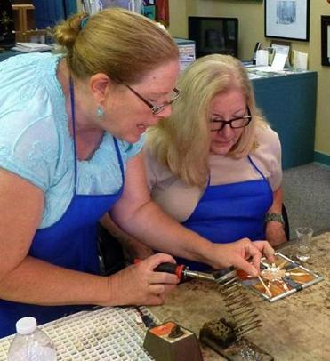 Instructor Diane Gilliam (left) instructs Patti Nickell  in proper use of a soldering iron.