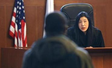 Judge Eleanor C. Sinnott took time Wednesday to inquire into defendants' well-being during sessions of the new court at the Edward W. Brooke Courthouse.