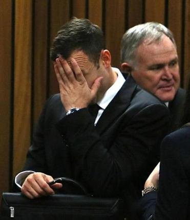 Oscar Pistorius (left) and his attorney Barry Roux on the third day of Pistorius's murder trial. AFP PHOTO/ POOL/ ALON SKUYIALON SKUYI/AFP/Getty Images