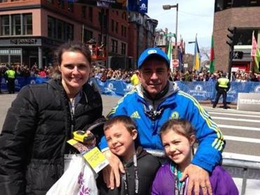 Dave McGillivray, his wife, Katie, and their children Luke and Elle, at the Marathon finish last year. This year McGillivray's family won't be attending the event with him.