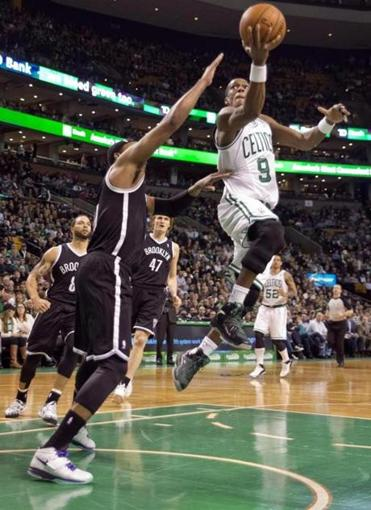 Celtics captain Rajon Rondo glided past ex=Celtics captain Paul Pierce en route to 2 of his 20 points. Rondo also had 9 assists and 7 rebounds.