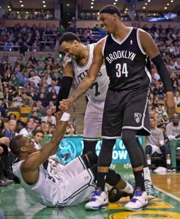 Rajon Rondo gets a little help from his friends — teammate Jared Sullinger and ex-teammate turned foe Paul Pierce.