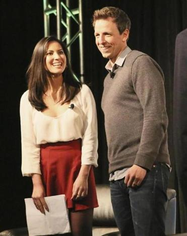Olivia Munn and Seth Meyers onstage at South by Southwest.