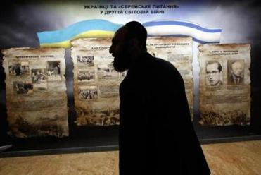 Zelig Brez, executive director of the Jewish Community of Dnepropetrovsk, walked past a display in the Ukrainian city's Holocaust Museum on Friday.