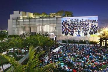 Crowds gather for the free outdoor wallcast concerts hosted by Miami Beach's New World Symphony.