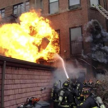Fire officials said heavy winds helped fan the flames as the nine-alarm blaze gutted the building on Beacon Street.