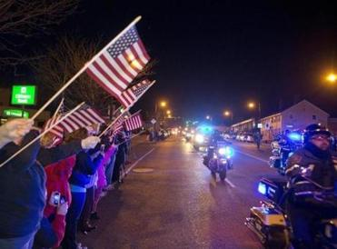 Supporters lined the procession bearing Firefighter Michael R. Kennedy's body.