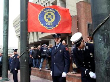 The Boston Fire Department's flag was raised at City Hall Plaza in mourning for the fallen firefighters.