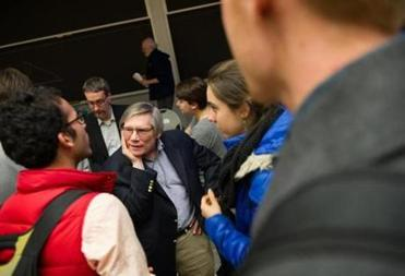 After a talk at MIT in April, Guth is mobbed by students and others with questions.