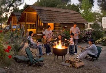 Whether you opt for a tent or a basic cabin, camping allows time to enjoy life's simpler pleasures, like making S'mores.