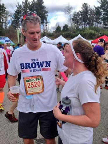 Scott Brown spoke Sunday with a fellow runner after a Bedford, N.H., road race.