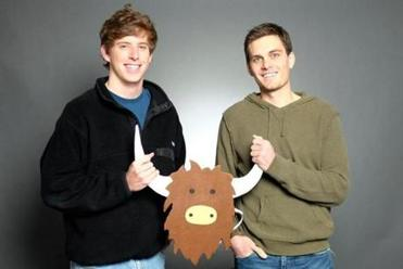 Yik Yak founders Brooks Buffington, left, and Tyler Drood with the logo for their site.