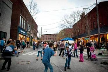 Merchants and artists participate in First Fridays, a street festival presented once a month from May through October.