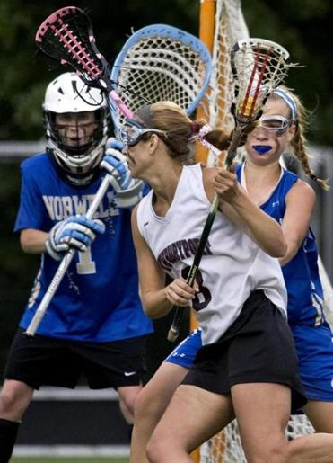 Julia Kipp on a goal-scoring run with pressure from Norwell's Grace Connerty and goalie Caroline Nichols.