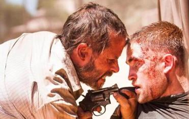 "Robert Pattinson (right) teams up with Guy Pearce in ""The Rover,"" a post-apocalyptic film set in the Australian outback."