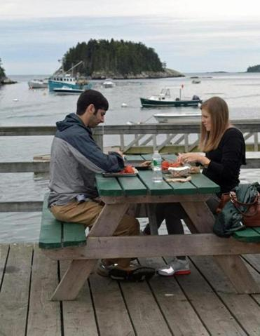 Picnic tables at Five Islands Lobster Co. offer glimpses of the working fisherman and lobsterman's life.