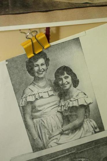 A photo of her mother and grandmother that she keeps near her desk.