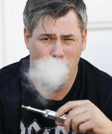 James Donessoni of Rhode Island can vape — use an e-cigarette — at his desk, but that's not the rule in all companies.