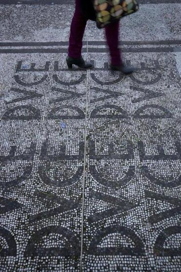 "Clockwise from left: The Foro Italico sports complex still retains its mosaic floors with Mussolini's title of ""Duce."""