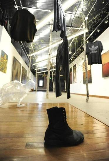 The exhibition includes pieces of clothing that had been worn by people who have died of drug overdoses.