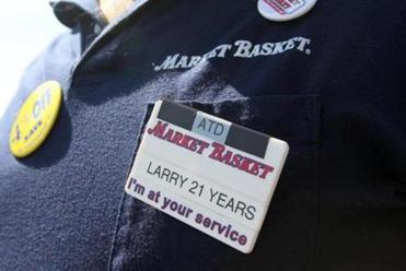 Larry Frost, a cashier at a Billerica Market Basket, wore black tape on his badge last week, saying he is mourning the ouster of Arthur T. Demoulas)