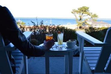 With cocktail or coffee in hand, guests can enjoy the oceanside view from the front porch of the Chatham Bars Inn, which celebrates its 100th anniversary in 2014.