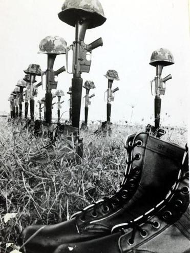 Helmets, jungle boots, and rifles are laid out for the dead of the US 101st Airborne Division killed in fighting in South Vietnam in December 1967.