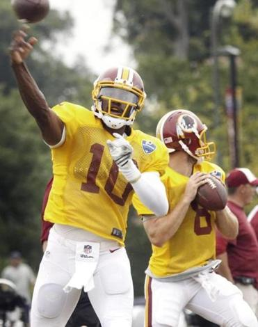 Robert Griffin III said he and Tom Brady spoke before their practice Monday in Richmond, Va.