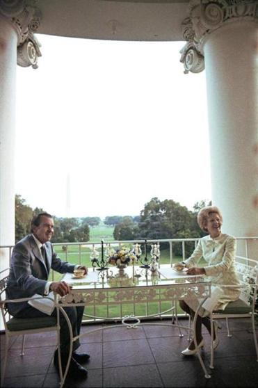 President Nixon and Pat Nixon having a cup of coffee on the Truman balcony. July 25, 1972.