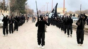 An undated image posted on a militant website on Jan. 14, purporting to show ISIS fighters marching in Raqqa, Syria.